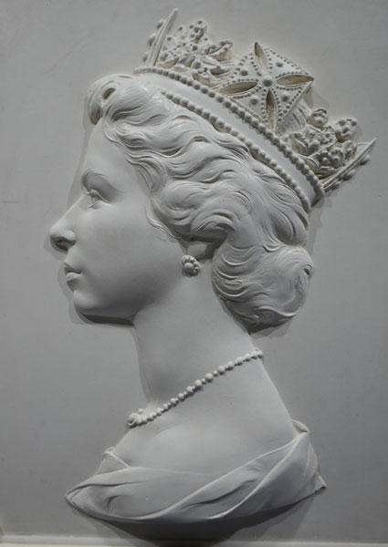 Queens stamp head sculpture