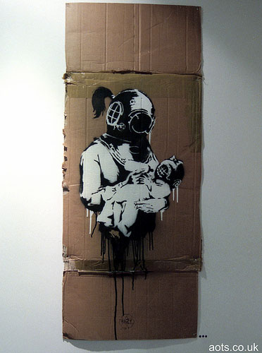 Banksy mother in diving mask with baby photo