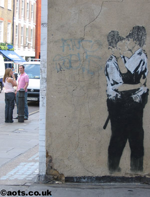 Banksy kissing coppers buffed