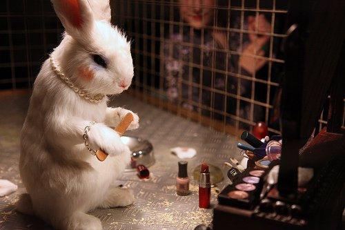 Banksy, rabbit wearing cosmetics