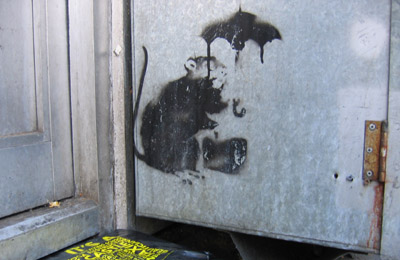 Banksy rat and umbrella