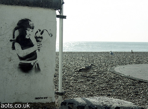 Banksy Seaside girl photo