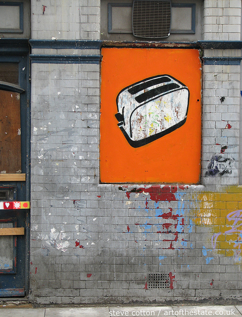 Toasters in a boarded up window