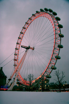 London Eye with snow and red lights