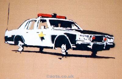 Banksy cop car on bricks