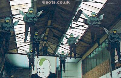 Banksy - flying coppers at Turf War