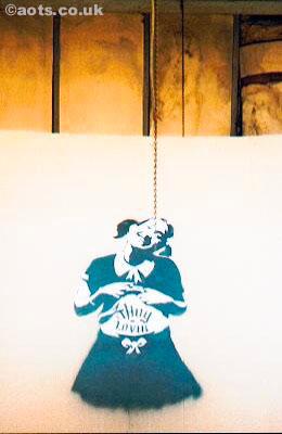 Banksy - Thug Lovin' on cardboard at Turf War