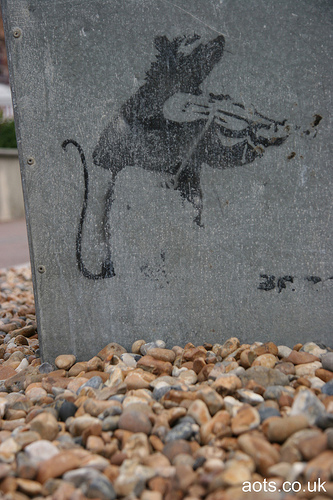 Banksy rat with violin