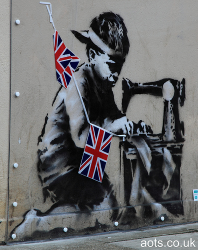 Banksy _ child sewing bunting