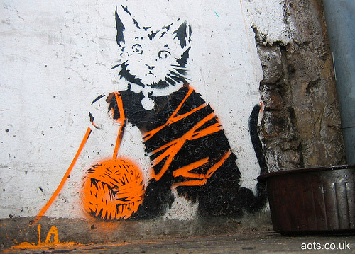 Banksy cat and orange wool