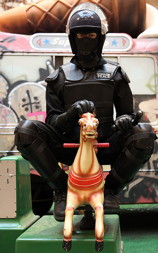 Banksy vs Bristol Museum - cop riding fairground ride horse