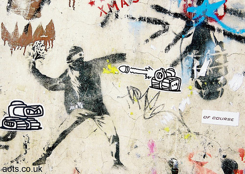 Banksy Rioter with flowers _ Love is in the air