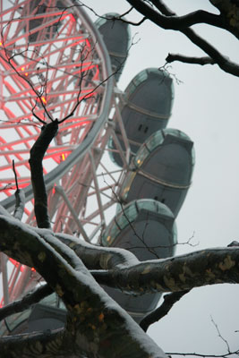 London Eye with snow covered tree