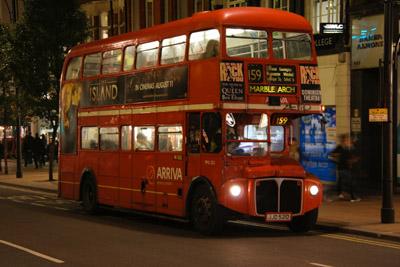 Routemaster bus at night
