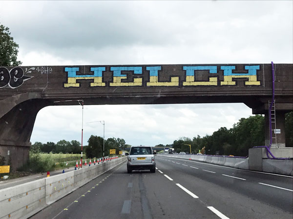 Photo of Helch graffiti on the M1