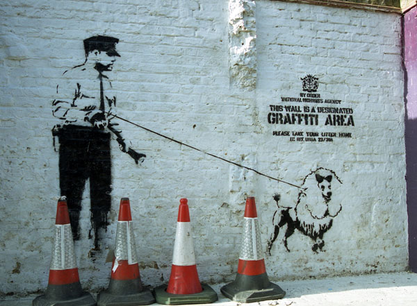 Banksy - Designated Graffiti Area with guard and dog