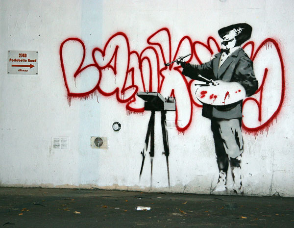 Banksy graffiti artist painter in Ladbroke Grove
