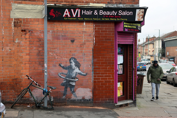 Banksy - Hula girl Nottingham with replacement bike